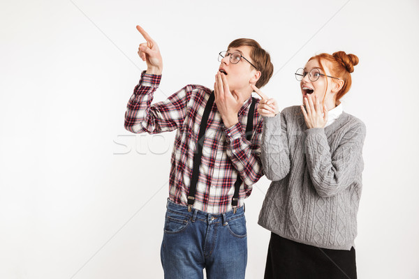 Cheerful couple of school nerds pointing fingers Stock photo © deandrobot