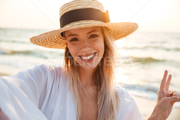Happy young girl in summer hat and swimwear Stock photo © deandrobot
