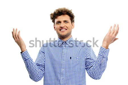 Young man with a kind of uncomprehending opened his arms to the sides Stock photo © deandrobot