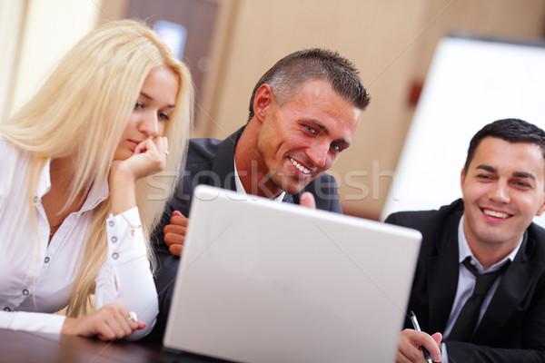 Sorridere lavoro persone seduta incontro di lavoro ufficio Foto d'archivio © deandrobot