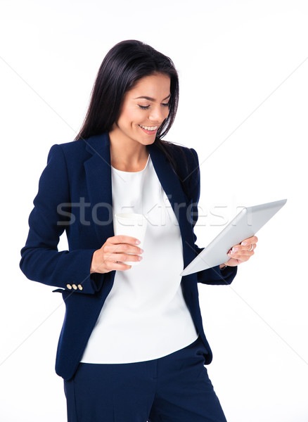 Smiling businesswoman with cup of coffee and tablet computer Stock photo © deandrobot