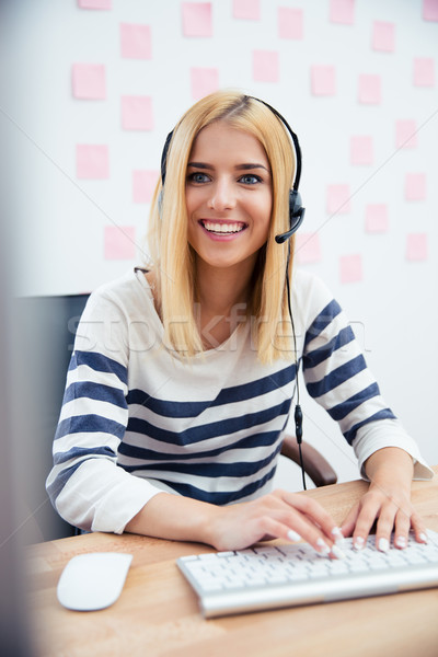 Lány headset számítógéphasználat fiatal lezser dolgozik Stock fotó © deandrobot