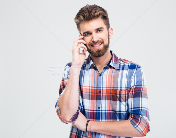 Happy man talking on the phone Stock photo © deandrobot