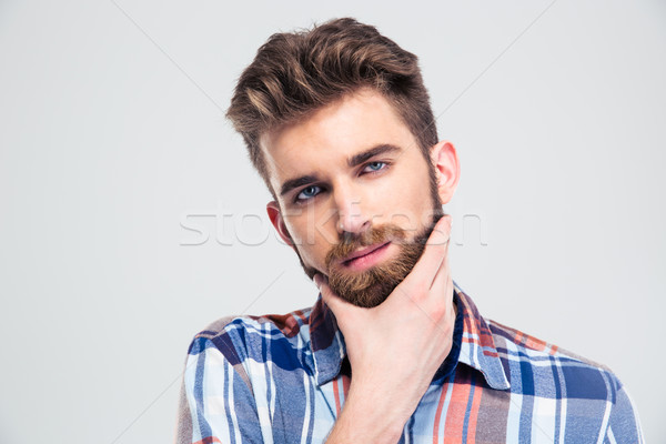 Portrait of a handsome man touching his chin Stock photo © deandrobot