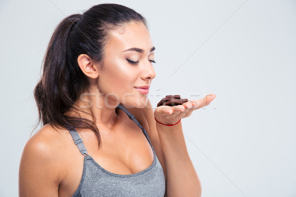 Portrait of a pretty girl smelling chocolate Stock photo © deandrobot