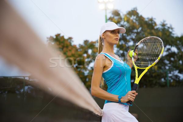 Stock photo: Portrait of a pretty female tennis player