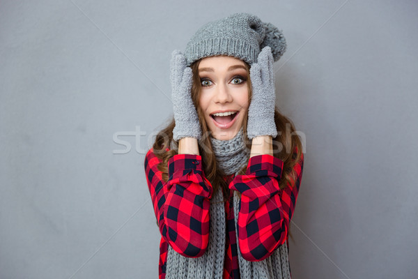 Happy amazed woman in winter cloth Stock photo © deandrobot