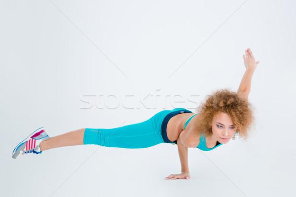 Woman doing fitness exercise Stock photo © deandrobot