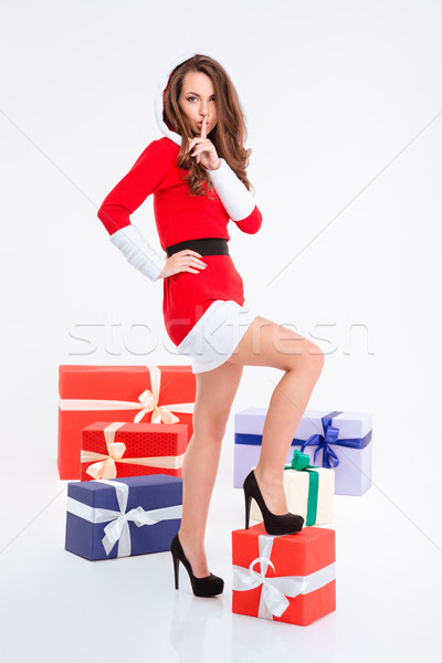Woman in santa claus cloth showing finger over lips Stock photo © deandrobot