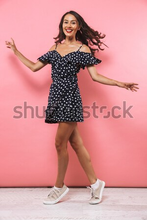 Comical woman in hat with light bulb holding fake moustache  Stock photo © deandrobot