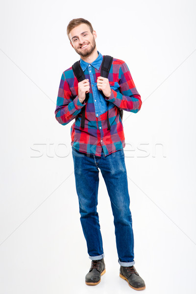 Full length portrait of a smiling male student Stock photo © deandrobot