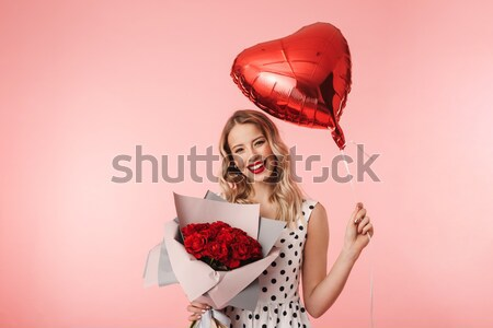 Tender charming young woman holding red heart  Stock photo © deandrobot