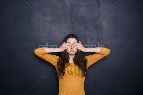 Young woman covering her eyes Stock photo © deandrobot
