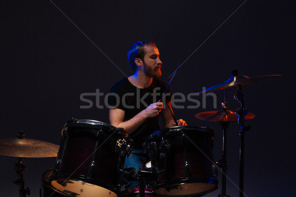 Handsome bearded man drummer playing his kit Stock photo © deandrobot