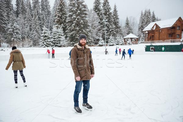 Man ice skating outdoors Stock photo © deandrobot