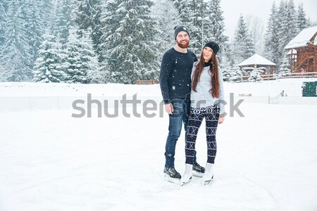 Stock photo: Couple making selfie photo on smartphone outdoors
