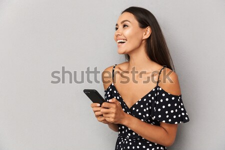 Stock photo: Happy surprised young woman in lace bra measuring her bust