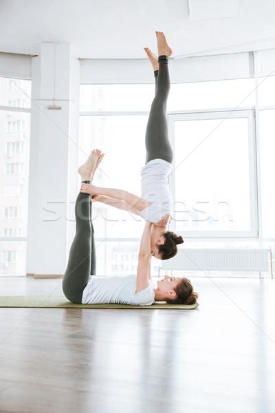 Dos cute las mujeres jóvenes yoga estudio Foto stock © deandrobot