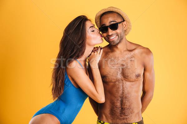 довольно девушки купальник целоваться африканских дружок Сток-фото © deandrobot