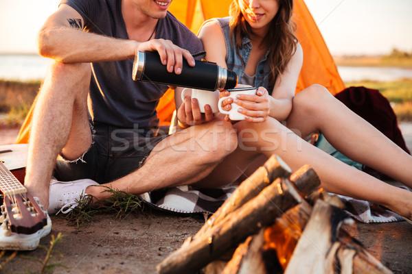 Afbeelding paar drinken thee vreugdevuur Stockfoto © deandrobot