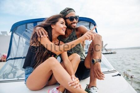 Szczęśliwy posiedzenia jacht portret wody Zdjęcia stock © deandrobot