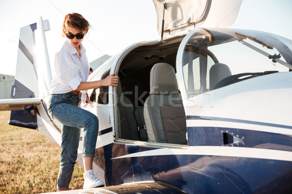 Woman pilot going to fly in small airplane Stock photo © deandrobot