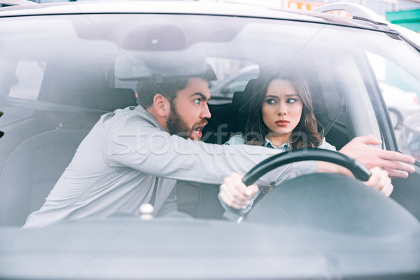 Irritated woman and man in car Stock photo © deandrobot