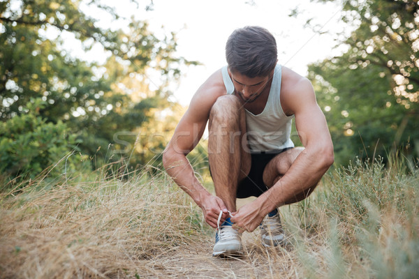 Stock photo: Runner preparing in forest
