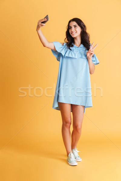 Kobieta niebieski sukienka zwycięstwo Zdjęcia stock © deandrobot
