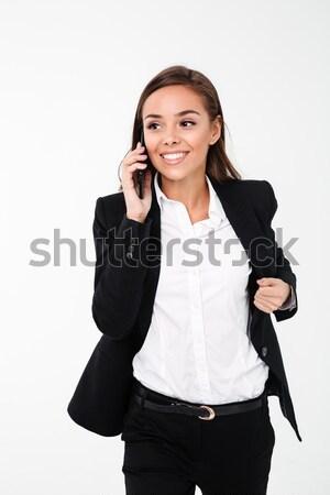 Belle brunette femme cheveux longs robe noire portrait Photo stock © deandrobot