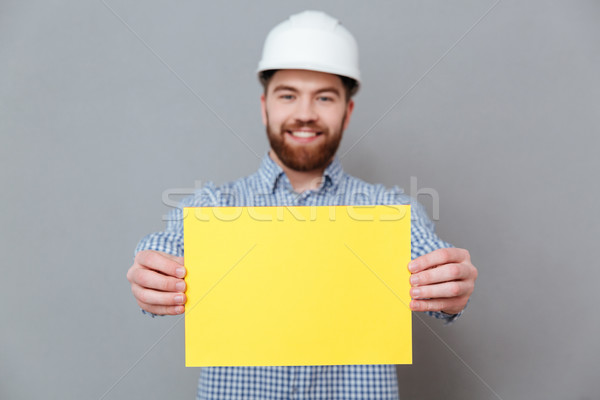 Bearded man builder showing copyspace blank to camera Stock photo © deandrobot