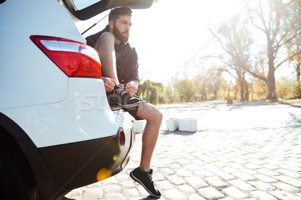Runner preparing in car Stock photo © deandrobot