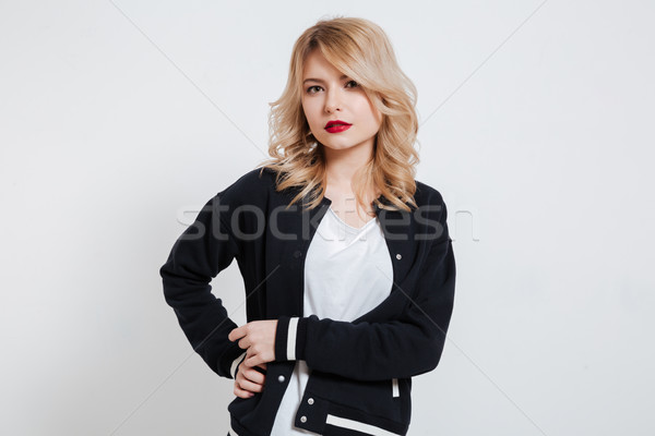 Portrait of a smiling attractive woman wearing casual clothes Stock photo © deandrobot