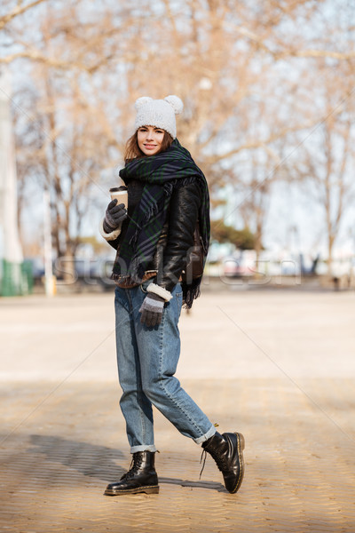 Woman drinking coffee and walking in the city Stock photo © deandrobot