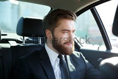 Homme costume séance Retour siège voiture Photo stock © deandrobot