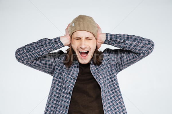 Screaming hipster covering ears Stock photo © deandrobot