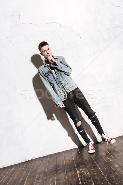 Hombre guapo pie piso silencio gesto Foto stock © deandrobot