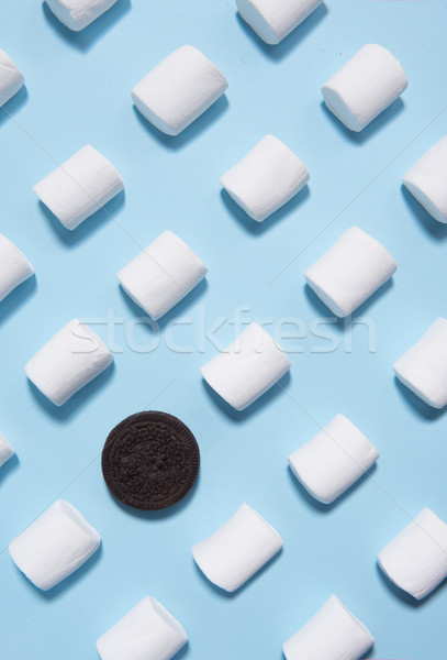 Sweeties marshmallows over blue table background. Stock photo © deandrobot