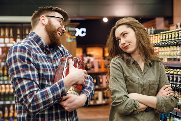 Man wants to by keg of beer but woman against Stock photo © deandrobot