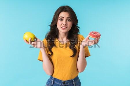Jovem mulher bonita em pé isolado imagem azul Foto stock © deandrobot