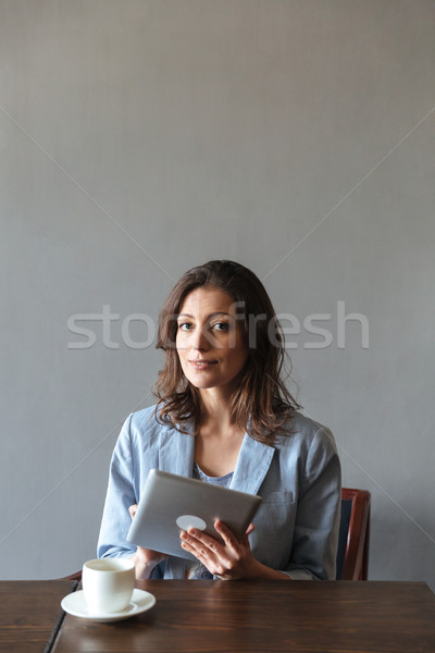 Kadın oturma resim Stok fotoğraf © deandrobot