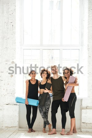 Full-length shot of positive people with training mats Stock photo © deandrobot
