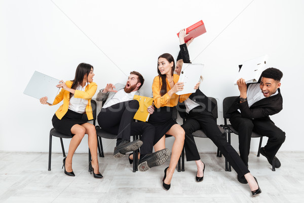 Screaming angry colleagues fighting with folders Stock photo © deandrobot