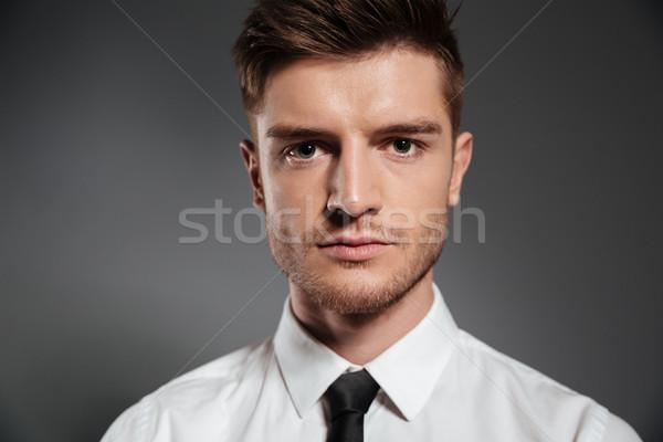 Guapo elegante hombre camisa empate mirando Foto stock © deandrobot
