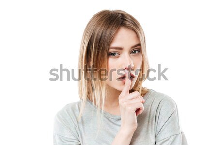 Amazing serious lady showing silence gesture Stock photo © deandrobot