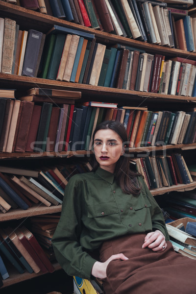 Portrait of girl in library looking camera Stock photo © deandrobot
