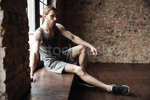 портрет серьезный молодым человеком спортивная одежда сидят Сток-фото © deandrobot