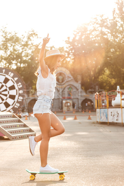 Concentrated young woman with skateboard outdoors Stock photo © deandrobot