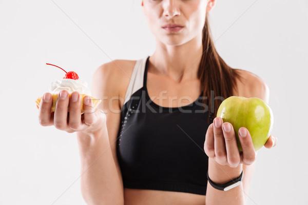 Close up portrait of a doubting sportswoman Stock photo © deandrobot