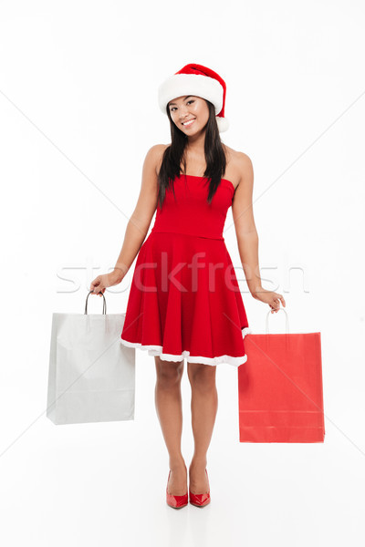 Stock photo: Full length portrait of a smiling happy young asian woman